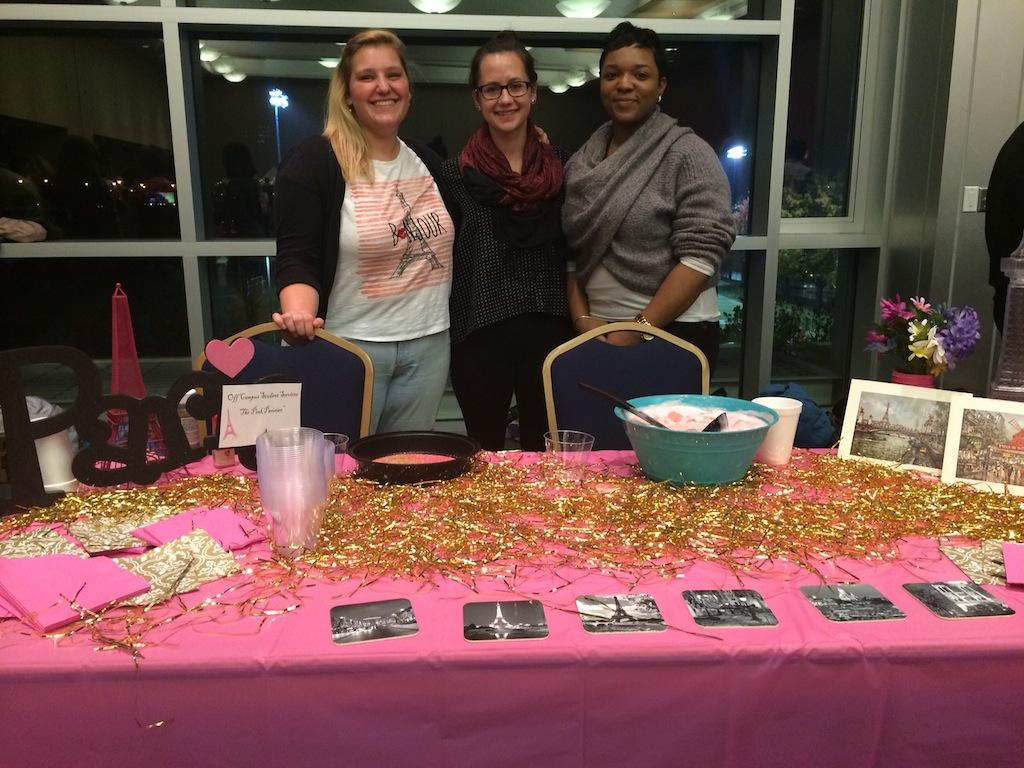 Jessie Bose, Emma Salzbrenner, and Essence Bradley from Off Campus Student Services and their Pink Parisian