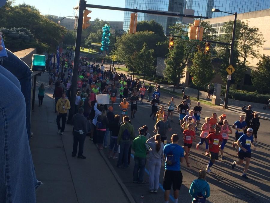 Marathoners+cross+mile+marker+9.7+of+the+26.2+miles