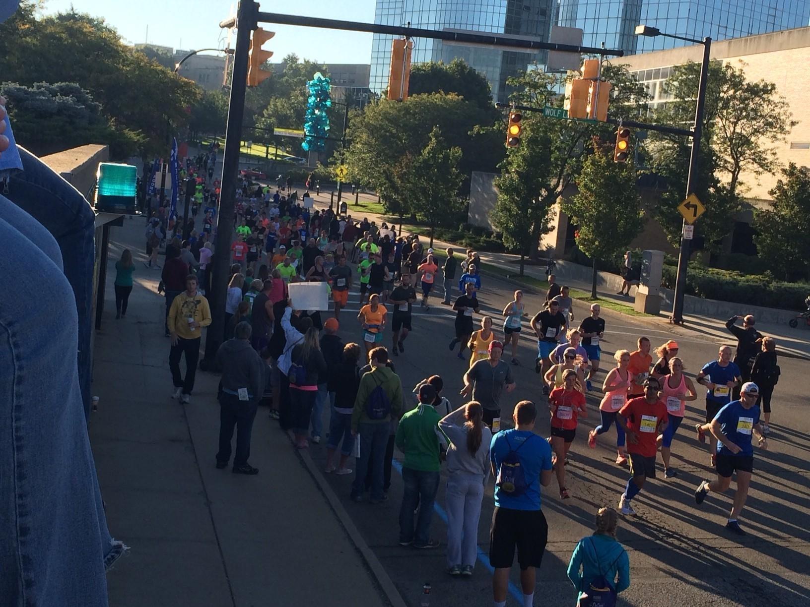 Marathoners cross mile marker 9.7 of the 26.2 miles