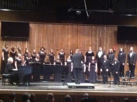 Bryan E. Nichols conducts the choir