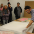 Graduate student, Ted Mallison, carefully unpacks the Warhol prints donated to the Myers School of Art