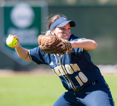 Softball wins big on road