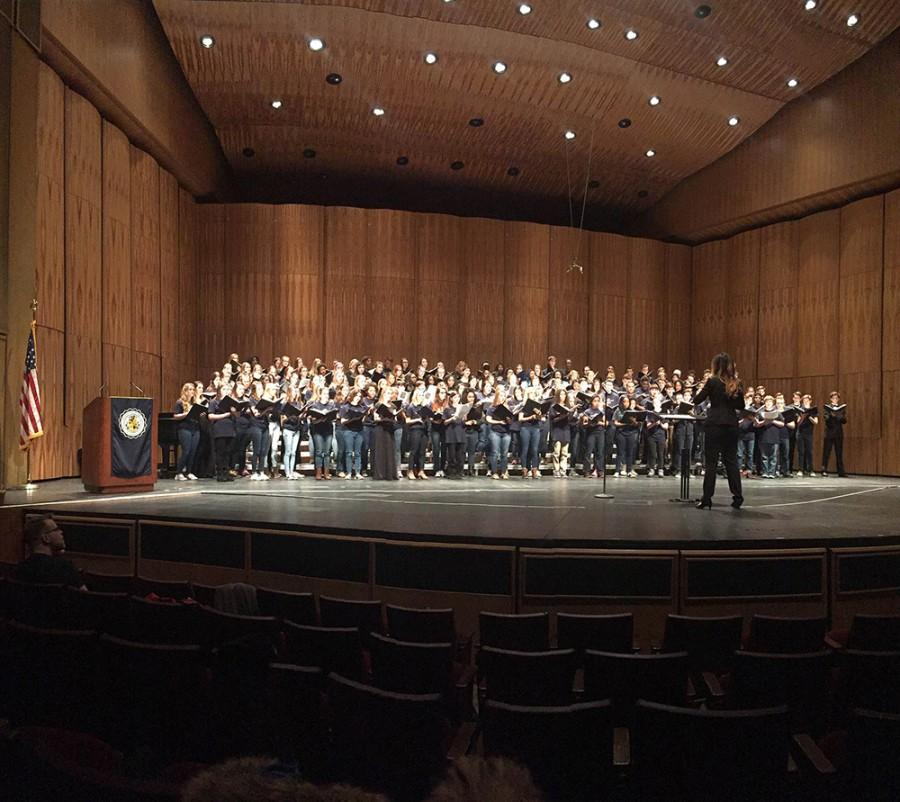 Choir+director+Marie+Bucoy-Calavan+directs+the+composite+choir+of+Lakewood+high%2C+Lake+high%2C+and+the+UA+chorus+in+the+finale+of+the+Vocal+Choral+Fest+Concert.