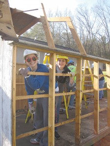While many of the workers constructed a shed, Cassandra Gouge, the secretary of UA Habitat for Humanity, and Taylor Graham, president of the group, are working on deconstructing a shed.