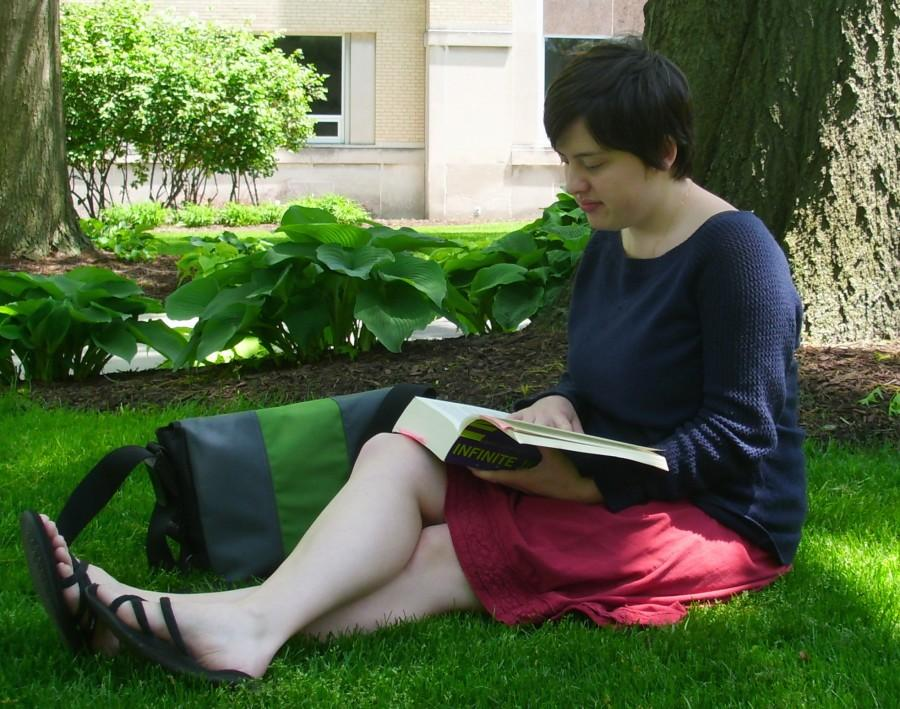 Amy Baird sits and enjoys the nice day as she studies for summer classes.