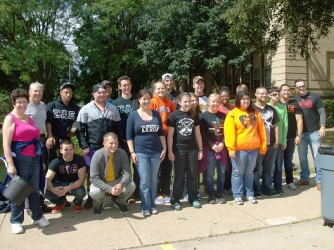 UAkron's ServeAkron volunteers pose for after a long day of yard work