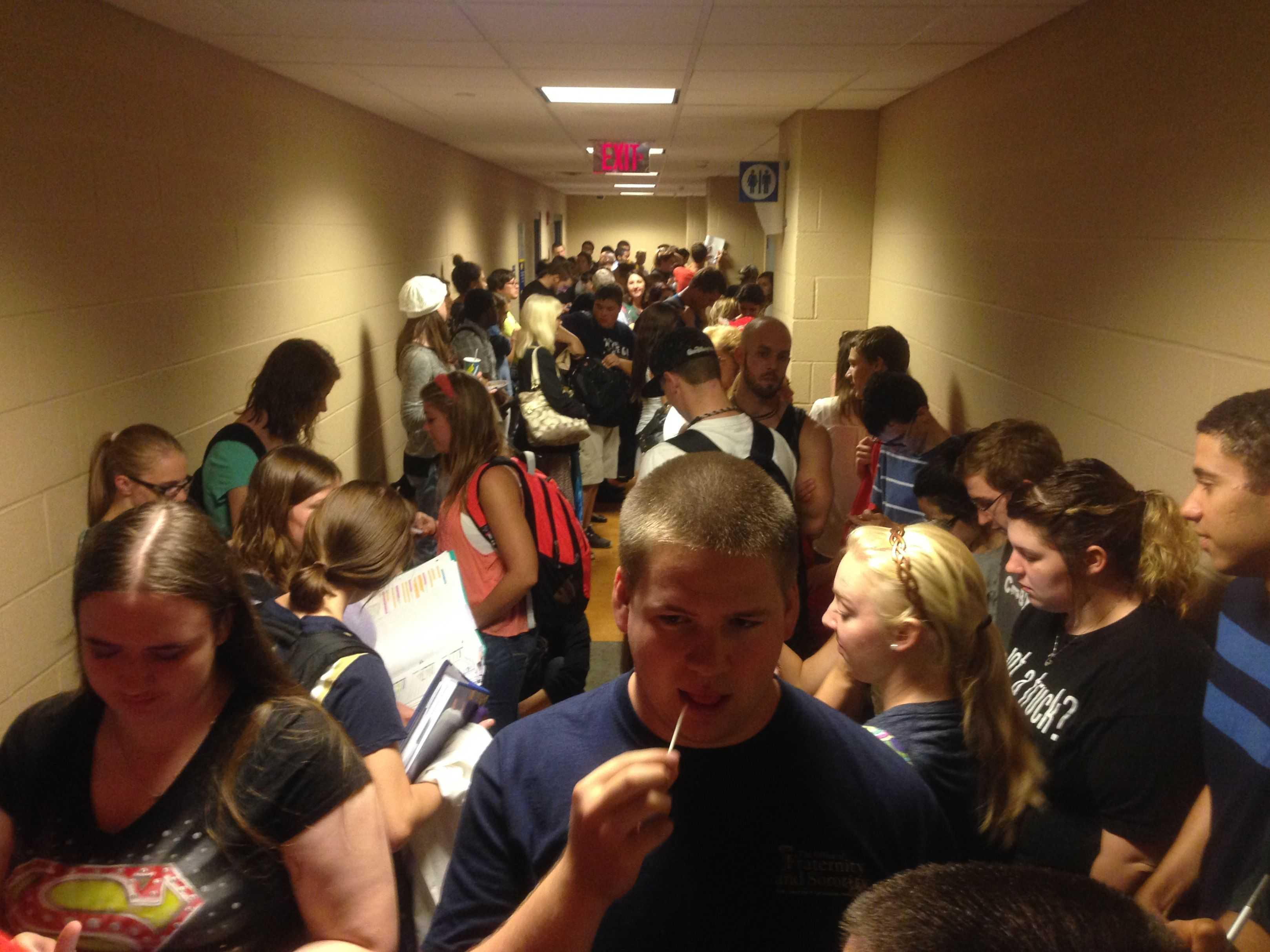Students take shelter in the basement of the Student Union during a tornado warning.