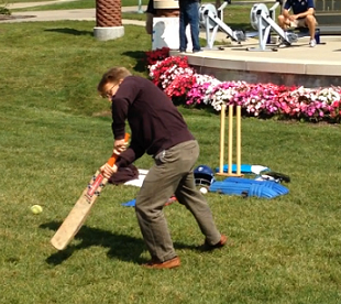 A student practicing his cricket swing.