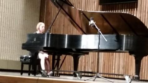 Faculty pianist Megan Denman plays in Guzzetta Hall.