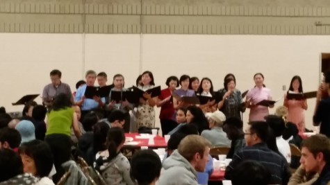 A choir from the Akron Chinese Church performs for the party.