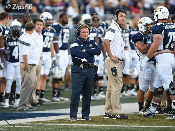Terry Bowden and his football team on the side line.