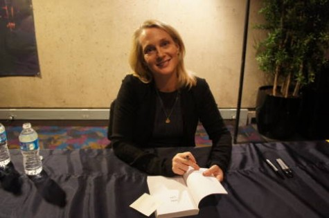 Author Piper Kerman signs books for fans in the lobby of EJ Thomas Hall.