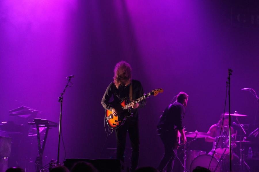 Fredrik Eriksson rocks out on guitar.