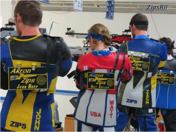 Rifle team shooting during competition.