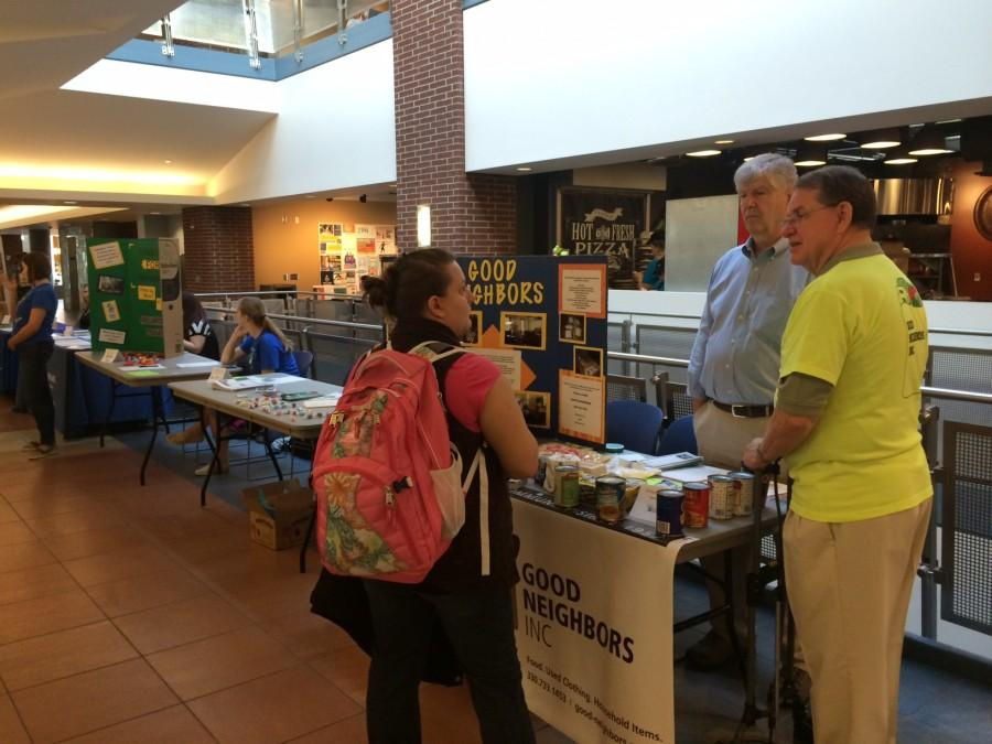 Good Neighbors Inc. answers questions to an aspiring volunteer