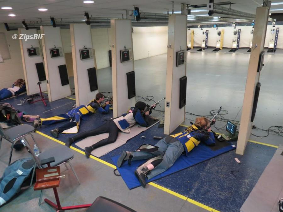 Akron's rifle team practicing for next match.