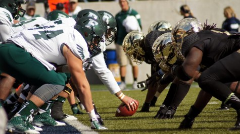 The UA's defensive line ready to attack the EMU's offense.