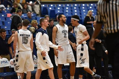 Team celebrating after a win at home against UMBC.