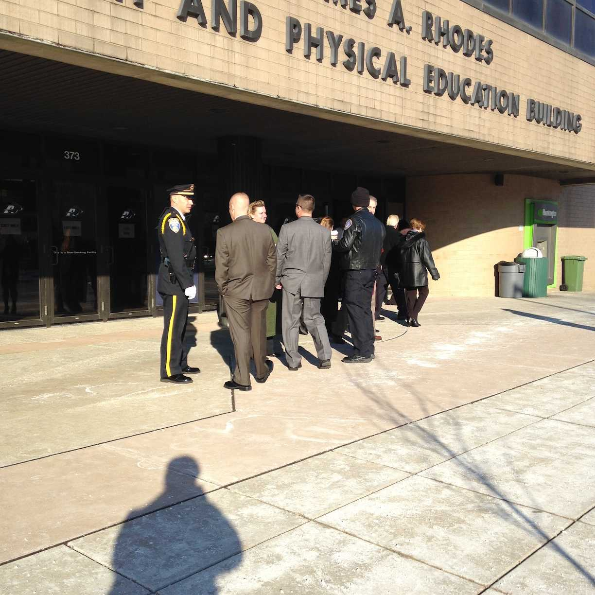 An officer monitors the line to get into the lobby of James A. Rhodes arena.