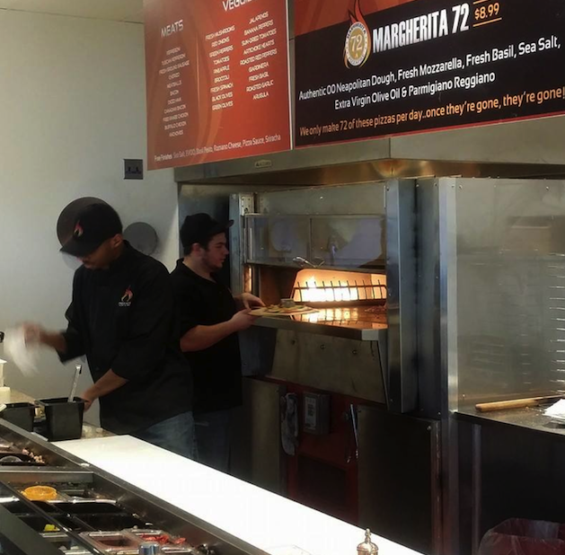 PizzaFire's assembly line prep station to customize your pizza