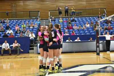 Volleyball celebrating a victory over the Central Michigan University.