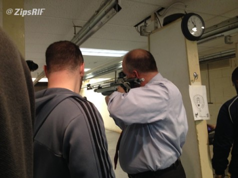 Rifle team showing guest how to shoot.