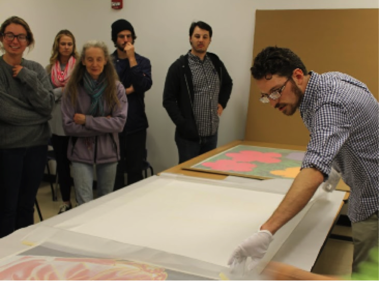 Graduate+student%2C+Ted+Mallison%2C+carefully+unpacks+the+Warhol+prints+donated+to+the+Myers+School+of+Art