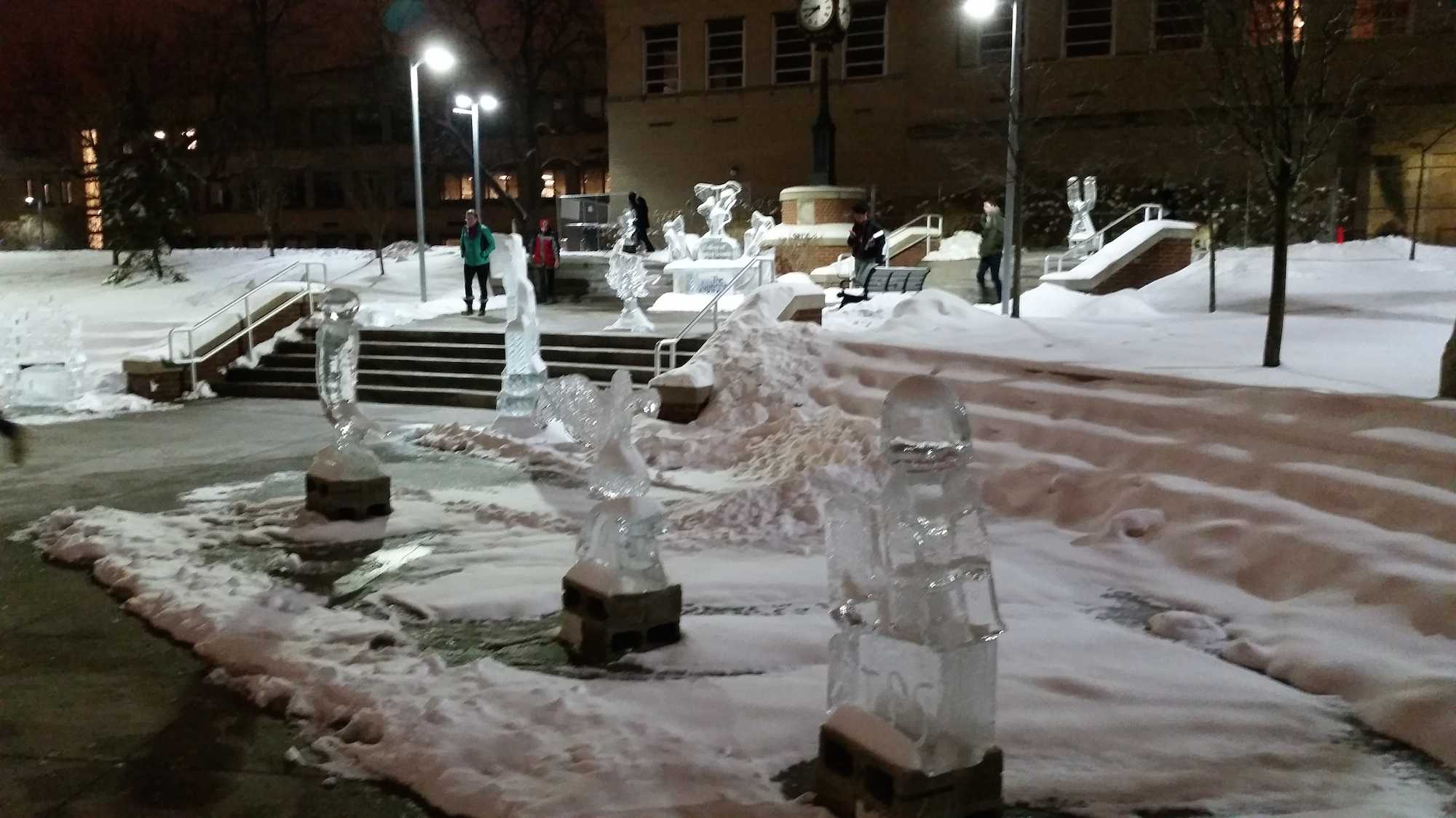 Light shines through the sculptures during the night hours on campus