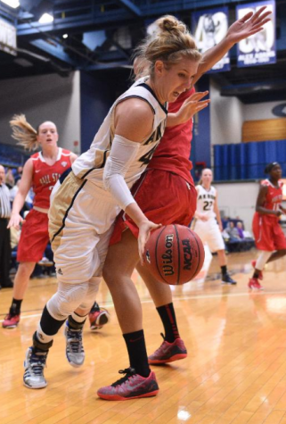 Sina King attacks the ball to the basket
