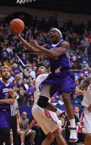 Deji Ibitayo taking the ball into the paint for a layup against Ball State.