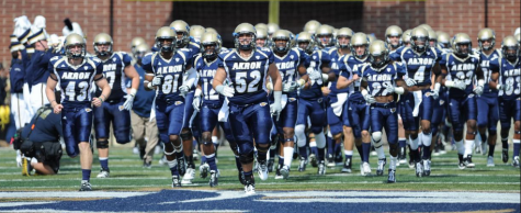 The Akron Zips football team takes to the field during a 2015 game at InfoCision Stadium. (Buchtelite file photo)