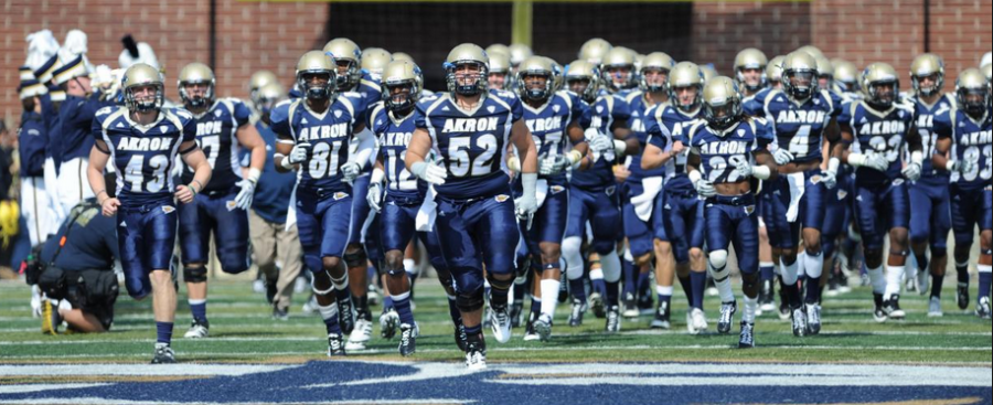 The+Akron+Zips+football+team+takes+to+the+field+during+a+2015+game+at+InfoCision+Stadium.+%28Buchtelite+file+photo%29