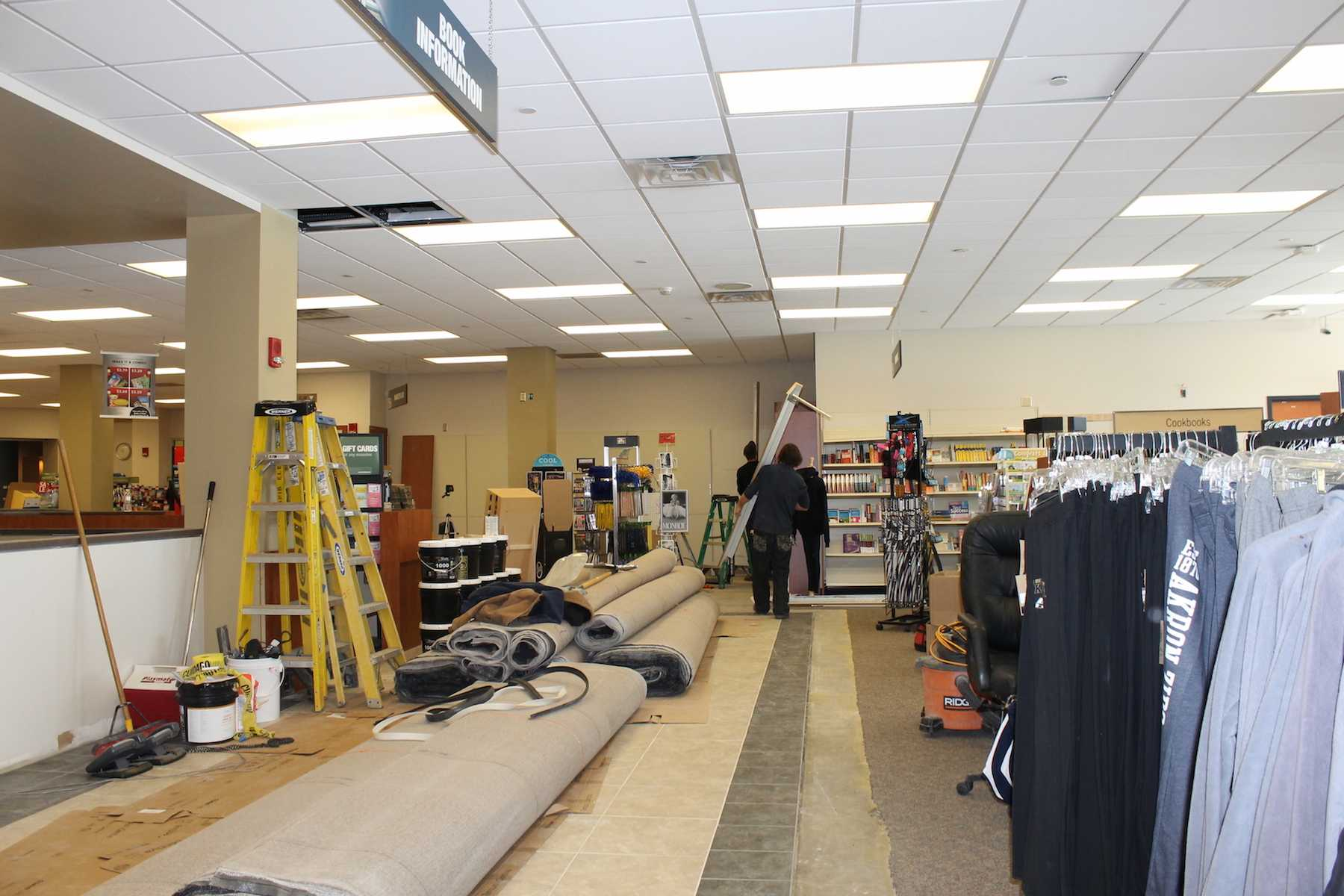 Workers install new carpet and build information center.