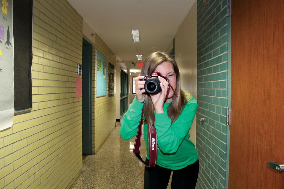 UA student Cat Fisher preparing to take a photograph.