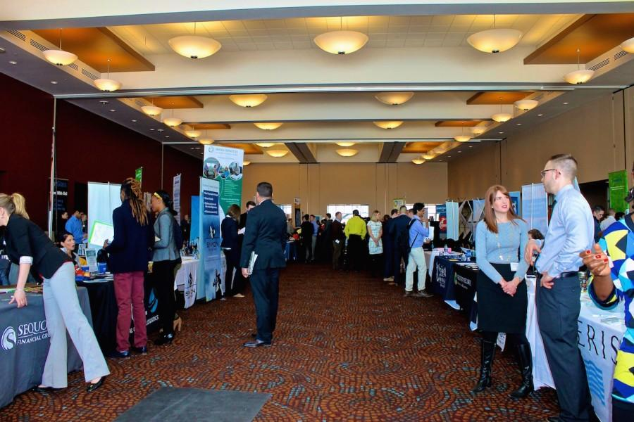 Students+evaluate+potential+career+choices+with+the+employers+assembled+at+the+Career+Fair+in+the+Union+ballrooms.+