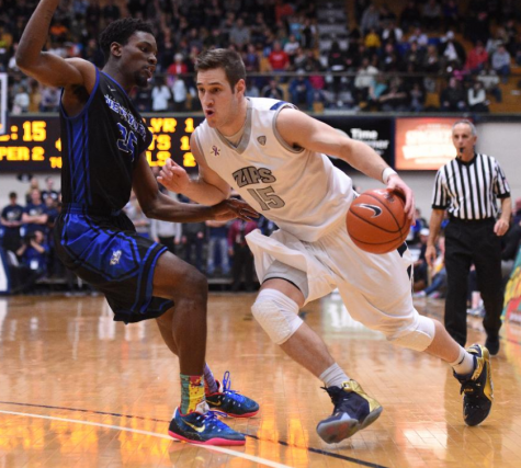 Jake Kretzer in the process of driving to the basket against UB.