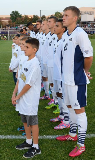The Akron mens' soccer team being introduced before a match at FirstEnergy Stadium.