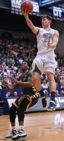 Reggie McAdams easily shakes off defender for an easy layup against rival Kent.