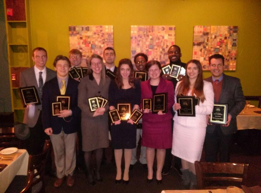 The Speech and Debate Team members pose at Bricco restaurant in downtown Akron after the OFA State Championship.