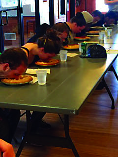 Students as they compete in the pie eating contest at silent weekend.