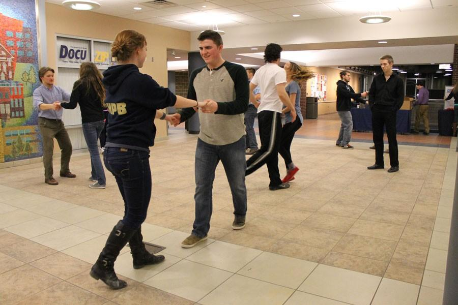 Students practicing the newly- learned swing moves on a cleared section of the Union Market