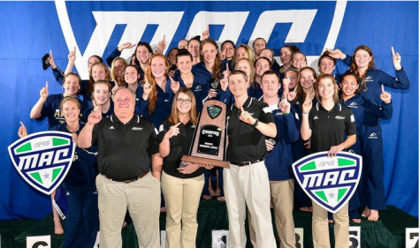 Akron's swimming and diving team after their victory in the pool.