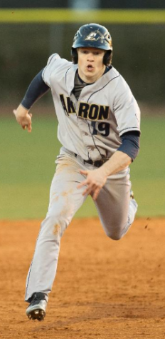 Joey Havrilak stealing a base in their game against the Fighting Irish.