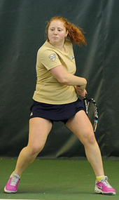 Olga Shkundina hitting the ball back against a Miami serve.