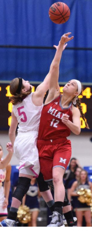 Kerri McMahan does a jump ball with Miami player.