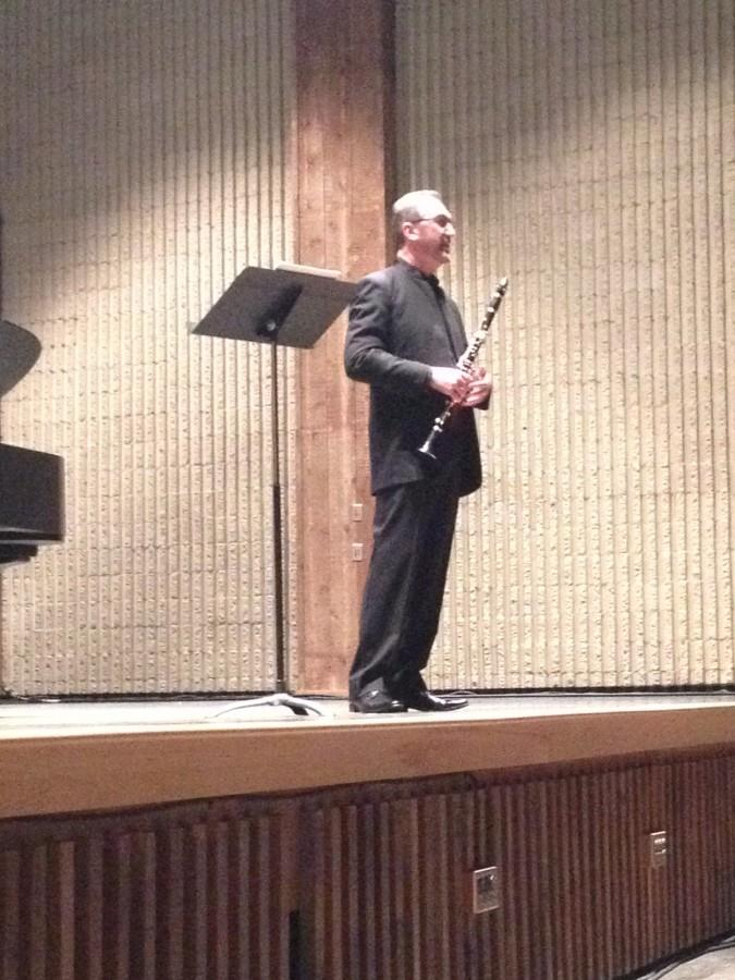 Nathan Williams addresses the audience before they began the concert in Guzzeta Hall