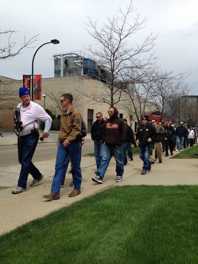 The procession of gun-advocates begins its walk on Hill Street.