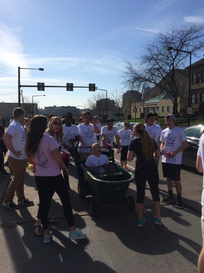 Lambda+Chi+Alpha+brothers+pull+Delta+Gamma+sisters+down+Market+Street+during+the+five-mile+annual+bathtub+pull.+