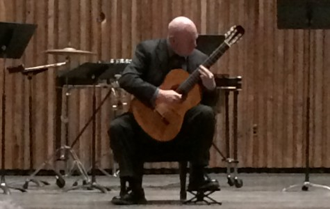 UA professor plays classical guitar pieces in recital