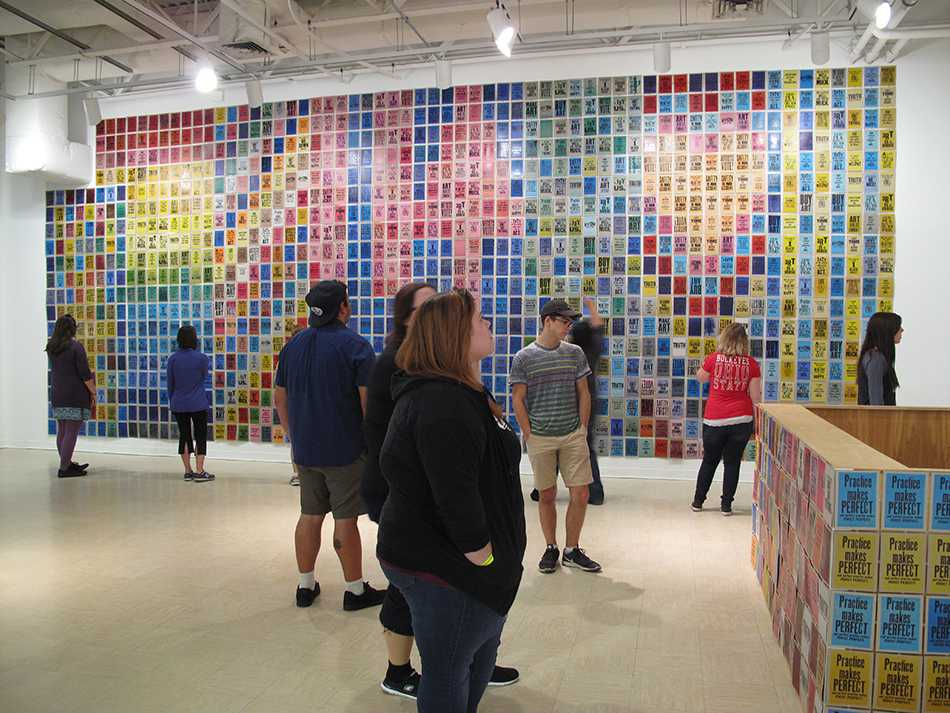 Visitors look at installation at Folk Hall by artist Kennedy.